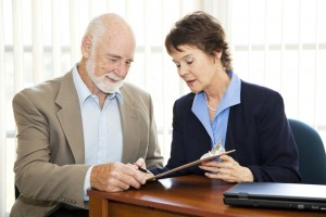iStock-119588361 Elderly man signing contract.jpg